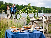 A mid-summer buffet by a lake (Sweden)
