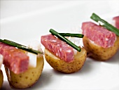 Potato and sausage canapes