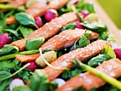 Oven baked rainbow trout with vanilla dressing on raw vegetables