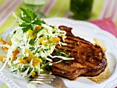 Grilled pork chop with coleslaw