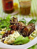 Beef roll kebabs on a bed of couscous