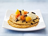 Coconut pancakes with exotic fruit salad