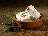 Sheeps' cheese with pepper, chillies and herbs