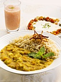 Dhaanshak (lentil curry), peach drink and an Indian egg-cheese dish