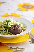 Beef medallion with fusilli and pesto