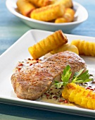 Veal steak with red peppercorns and potato croquettes