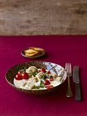 Chestnut gnocchi with Bergkäse cheese sauce & cherry tomatoes