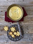 Cheese cream soup in a small pan with Parmesan stars