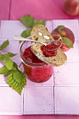 Raspberry and peach jam with a slice of almond bread
