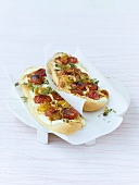 Focaccia topped with tomatoes, fresh goat's cheese & pine nuts
