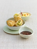 Sweet spring rolls, pineapple stuffing, chilli chocolate dip