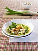 Spring onion soup with croutons and Parmesan