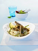 Sea bream with basil sauce on mashed potato with lime