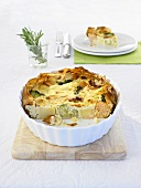 Potato and salmon quiche in a quiche dish