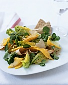 Watercress salad with cooked turkey breast and mango