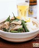Chicken curry with coconut sauce, coriander and rice