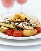 Chicken breast with thyme and lemon on braised vegetables