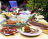A selection of grilled dishes on a table out of doors