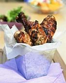 Grilled chicken legs marinated in honey and coriander