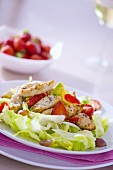 Iceberg lettuce with chicken breast, avocado & strawberries