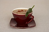 A cup of hot chilli chocolate with chilli