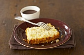 Slice of baked rice loaf with pineapple, ginger & chocolate sauce