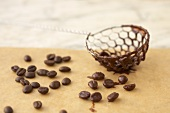Chocolate-coated coffee beans and sieve