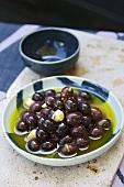 Black olives in spiced oil