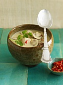Chicken and coconut soup with coriander leaves and chilli