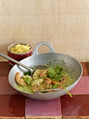 Prawns in coriander and coconut sauce in a wok