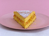 A piece of polenta cake with orange filling