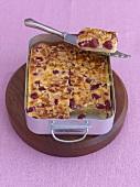 Cherry sour cream cake in a roasting tin
