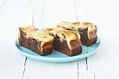 Three chocolate cheesecake brownies