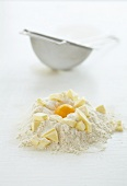 Ingredients for shortcrust pastry with sieve