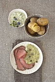 Slices of roast beef with potatoes, remoulade & herb sauce