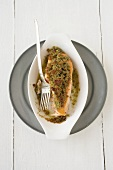 Salmon fillet with herb crust in a baking dish