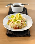 Rice noodles with leek rings and sweet & sour chilli sauce