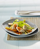 Sea bream on vegetables with sweet and sour sauce