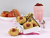 Whole grain muesli bars and oat biscuits with raspberries