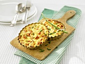Two crustless vegetable quiches in quiche tins