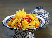 Fried vegetables with pineapple in a china bowl