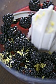 Blackberries with lemon zest in a food processor