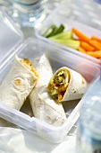 Wraps filled with vegetables in a plastic box