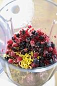 Mixed, frozen berries in liquidizer for berry drink