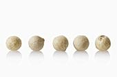 Five white peppercorns