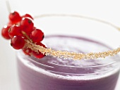Banana and berry smoothie with sugared rim