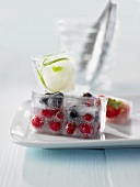 Berries and lime zest frozen in ice cubes