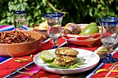 Three chicken and vegetable burgers out of doors (Mexico)