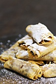 Baked filo pastry rolls with honey and fig filling