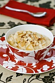 Rice pudding with apple, mascarpone and flaked almonds